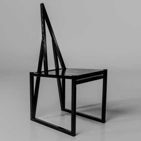 Aalto University students experiment with stained-black wood to create chairs