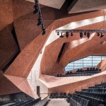 Fernando Menis combines crushed brickwork and concrete for cavernous concert hall in Poland