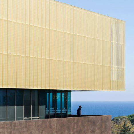 Cultural Centre of Bastia contrasts a dark concrete base with a golden crown