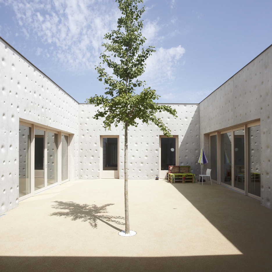 Epilepsy care home by Atelier Martel features stippled concrete walls