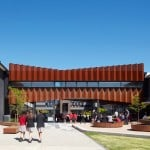 """Branch Studio Architects embellishes school """"flyover"""" with concertinaed Corten screen"""