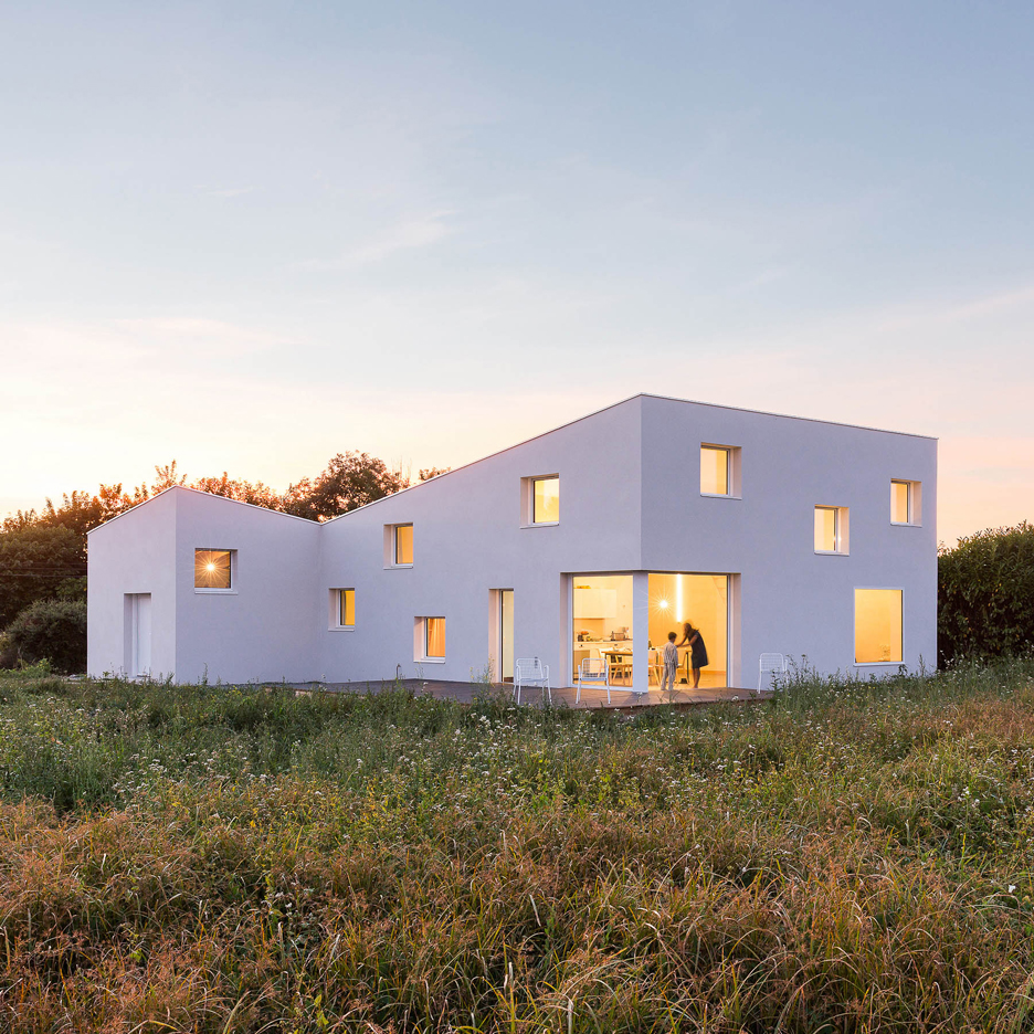 Square windows puncture Alireza Razavi's monolithic House for a Photographer in Brittany