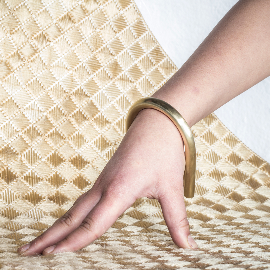 Zsofia Kollar weaves human hair to create golden perfumed textile