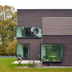 Architektuurburo Dirk Hulpia completes house in Belgium with protruding corner windows
