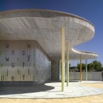 Wavy concrete roof shelters corrugated metal kindergarten by Gabriel Verd in Spain