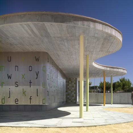 Wavy concrete roof shelters corrugated metal kindergarten by Gabriel Verd in Spain