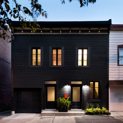 Architecture Open Form creates black facade for historic Montreal home