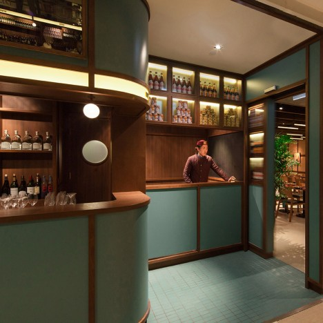 NC Design & Architecture hides Hong Kong restaurant behind grocery stall