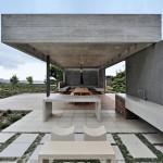 Concrete garden pavilion by Metropolis offers outdoor dining to a Cape Town villa
