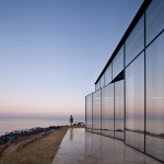 Platform_a completes reflective glass and volcanic stone cafe on Jeju island coast
