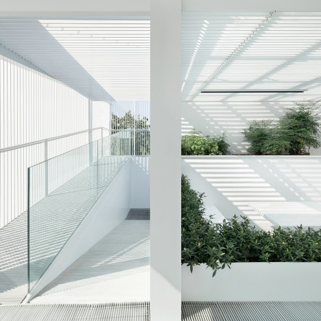 ReMIX Studio's Shunyi House extension features louvred cladding and an all-white interior