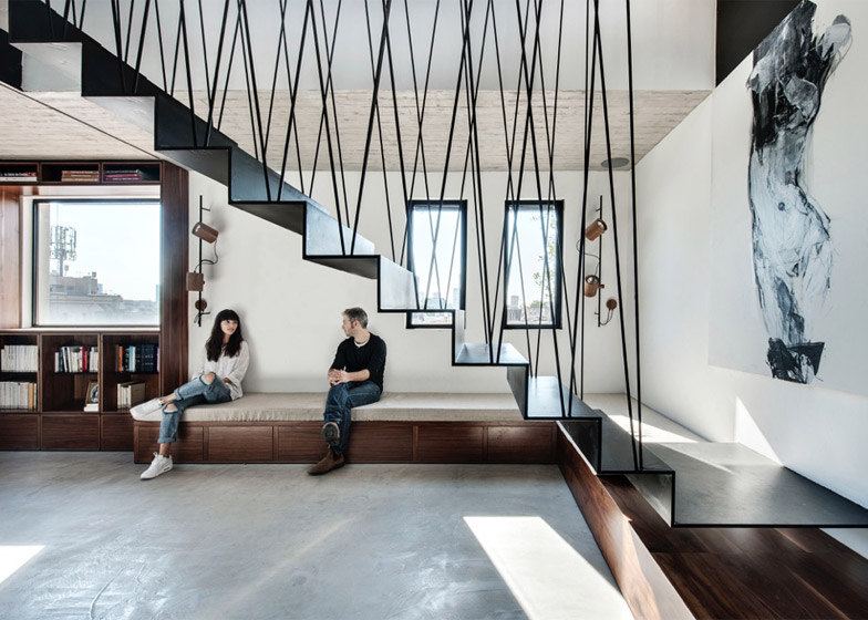 Toledano architects renovate Tel Aviv apartment and add a black metal staircase