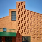The Green community centre by AOC features herringbone-patterned brickwork