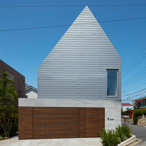 Kentaro Ishida adds stripy steel skin to asymmetric house in Japan