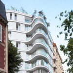 ECDM adds curving glass and steel apartment block to a Paris street