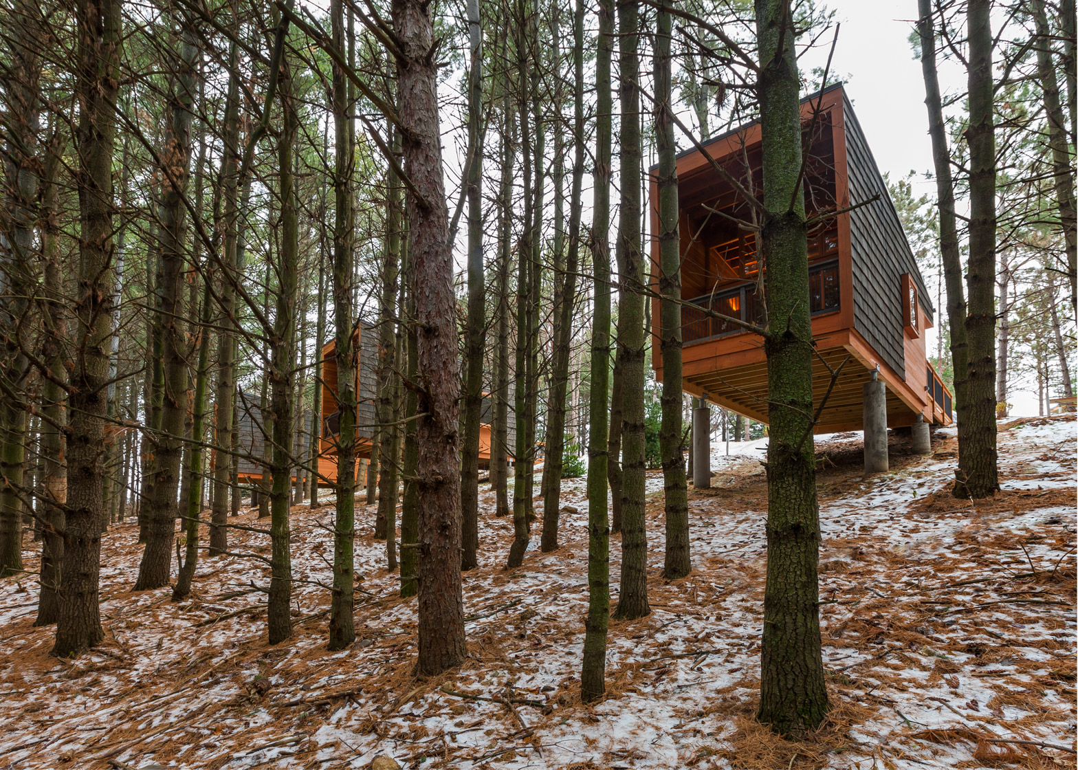 Whitewail Woods cabins by HGA