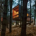 HGA perches cedar-clad cabins on a forested hillside in Minnesota