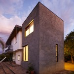 "Phillip Lühl uses ""bagged concrete bricks"" to build two extensions to a Namibia house"