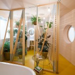 "Husos adds plant-filled ""bathyard"" to apartment in Madrid"