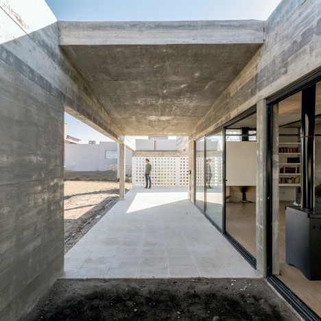 Raw concrete and black-painted metal give industrial appearance to house by Tectum