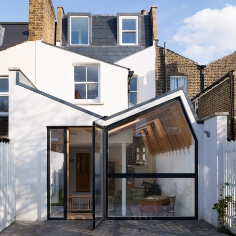 "Forrester Architects' London house extension has a ""butterfly"" roof and exposed wooden rafters"