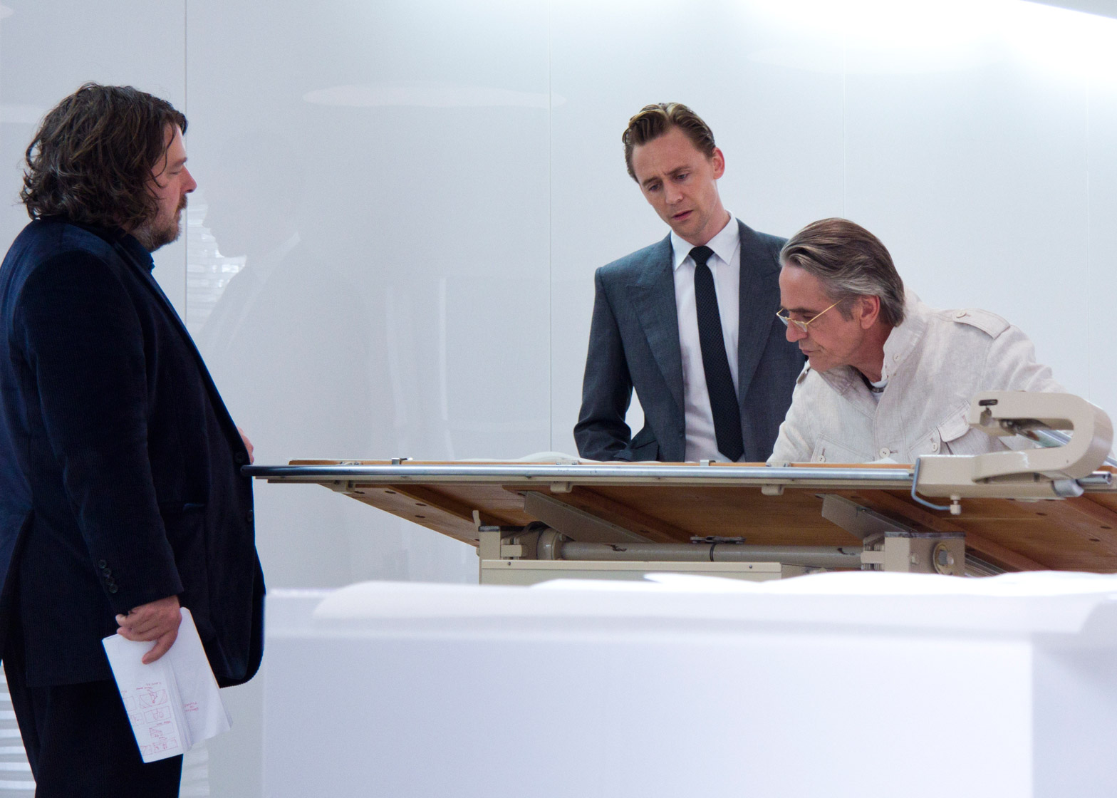 Director Ben Wheatley (far left), with Tom Hiddleston playing High Rise resident Dr Laing and Jeremy Irons paying architect Royal