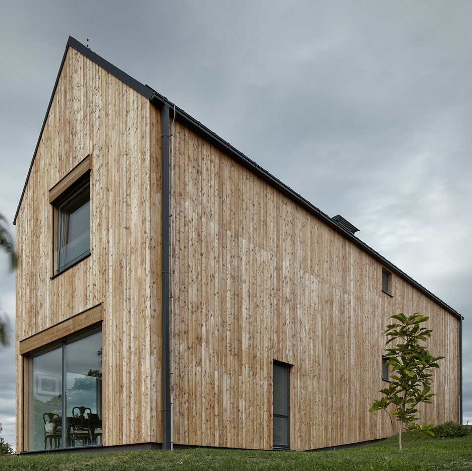 Mjölk Architekti references agricultural architecture for barn-like house