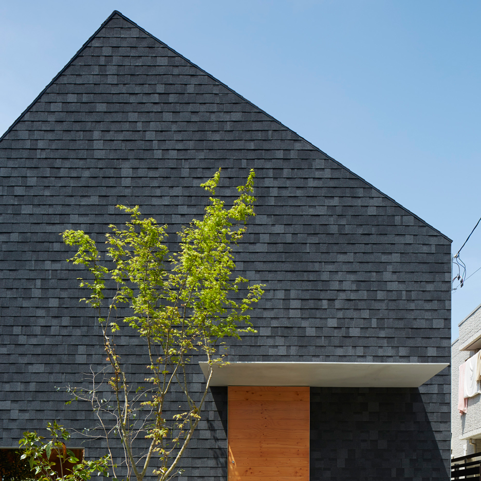 Suppose Design Office hides garden beneath oversized shingle roof of House in Anjo