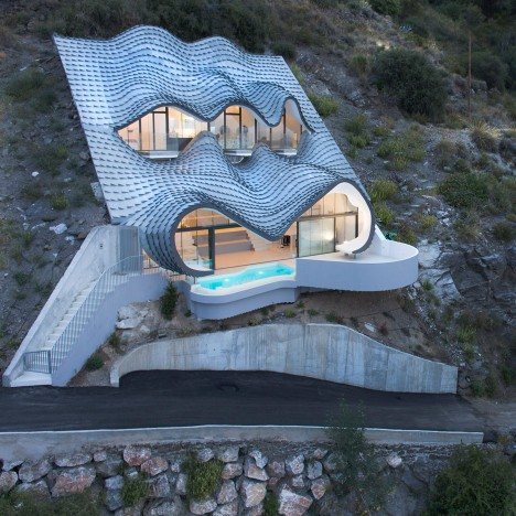 House on the cliff by Gilbartolome Architects in Granada, Spain