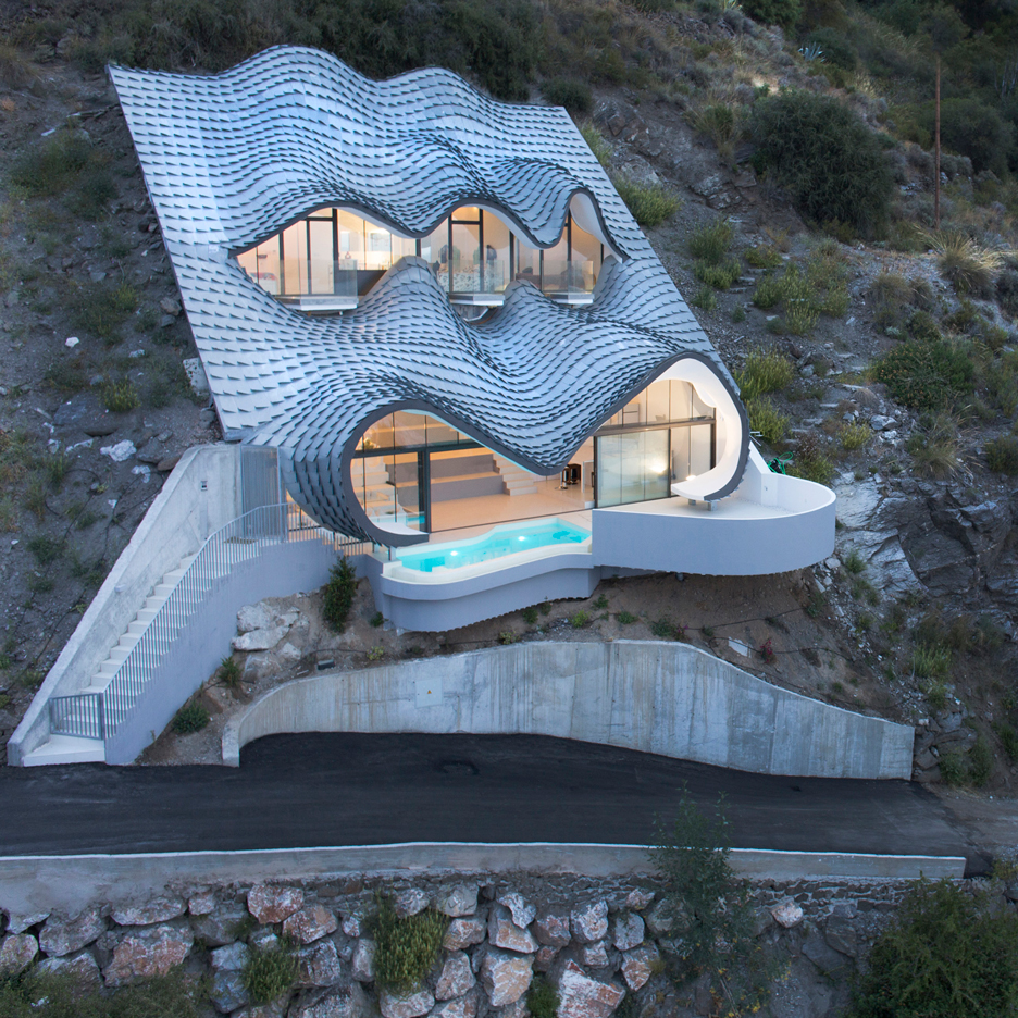 "GilBartolomé Architects creates cavernous ""Gaudiesque"" residence with a zinc-shingled roof"