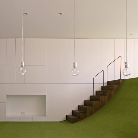 Mitsuharu Kojima creates curved grass-like floor inside Japanese family house