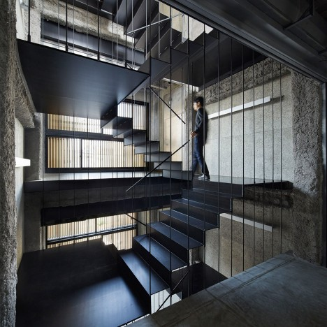 Continuous staircase connects eight levels in K8 bar building by Florian Busch