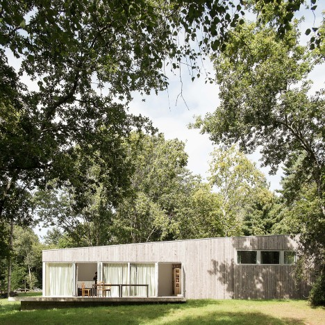 Atelier MIMA completes timber-clad holiday home overlooking a river in rural France
