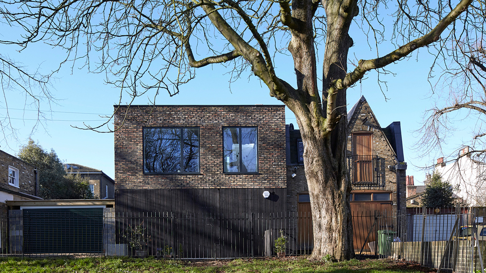 SAM Architects uses brick and charred wood for London house