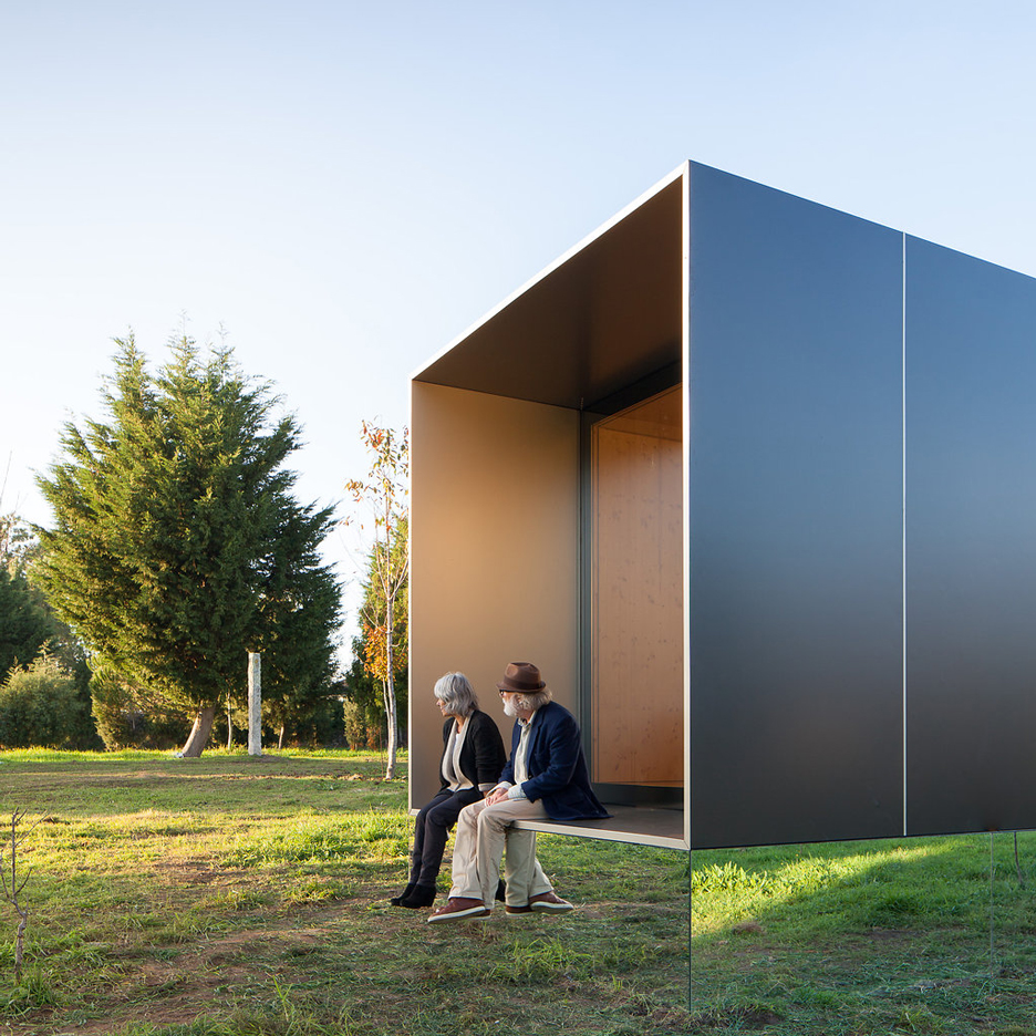 MIMA Light is a small prefabricated house raised up from the landscape on a near-invisible base