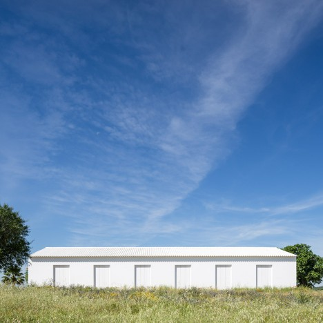 Aboim Inglez Arquitectos adds bright white extension to farmhouse in rural Portugal
