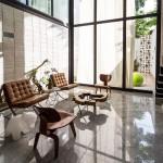 Huge glass doors open Taller Estilo Arquitectura's Mexican house to a courtyard garden