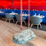 Rolf Sachs suspends chunk of rock inside Saltz restaurant