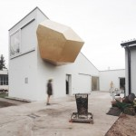 "Warsaw art studio features meditation space inside ""deformed golden object"""