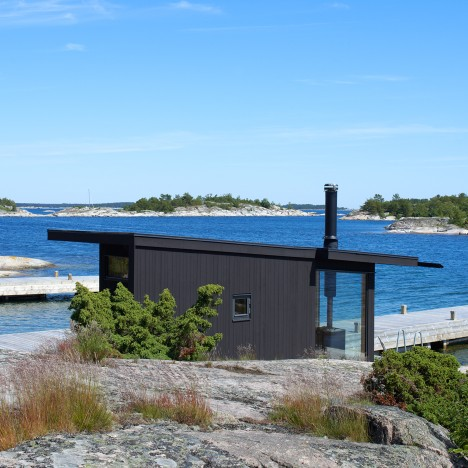 Margen Wigow Arkitektkontor models blackened timber holiday home on Swedish fishing huts