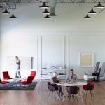 A collaborative workplace containing products by Haworth alongside furnishings by Cappellini and Poltrona Frau
