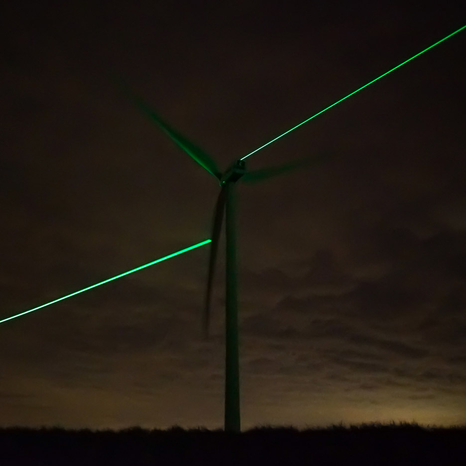 "Daan Roosegaarde uses green lasers to showcase the ""beauty"" of wind turbines"
