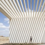 Slatted roof casts dramatic shadows over gateway to new university campus in Brazil