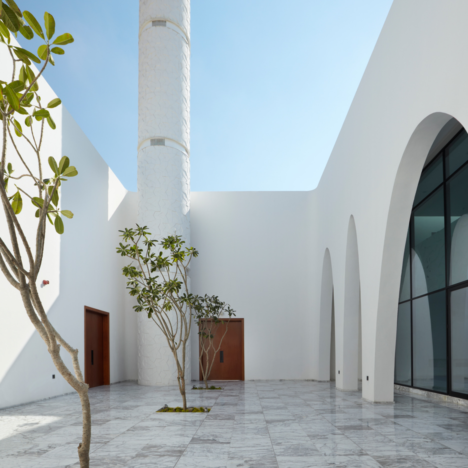 Ibda design uses contrasting sandstone and white marble for Home of architecture uae