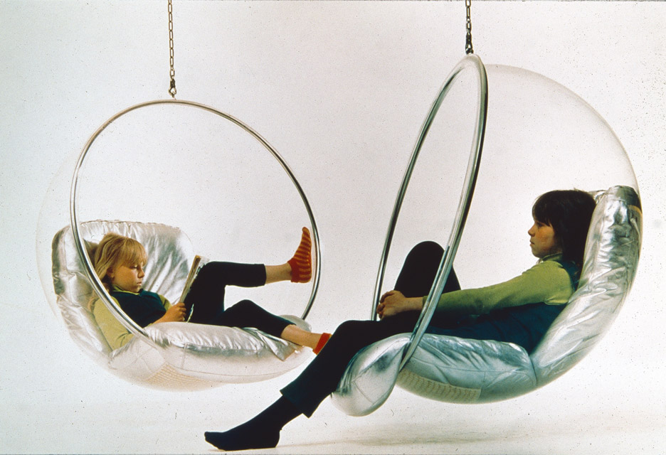 Aarnio's daughters Rea and Marja-Leena in Bubble Chairs, early 1970s