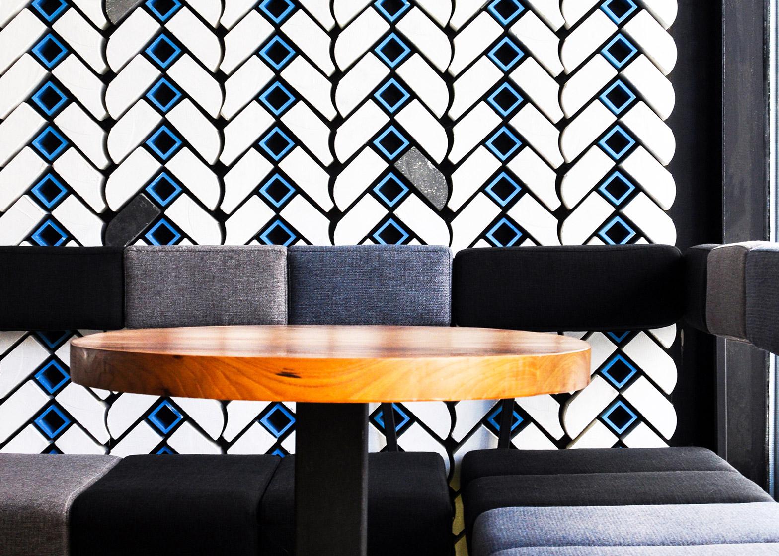 Beijing bar by Studio Ramoprimo has chevron-patterned walls