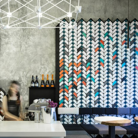 Studio Ramoprimo creates chevron-patterned brick walls inside Beijing wine bar