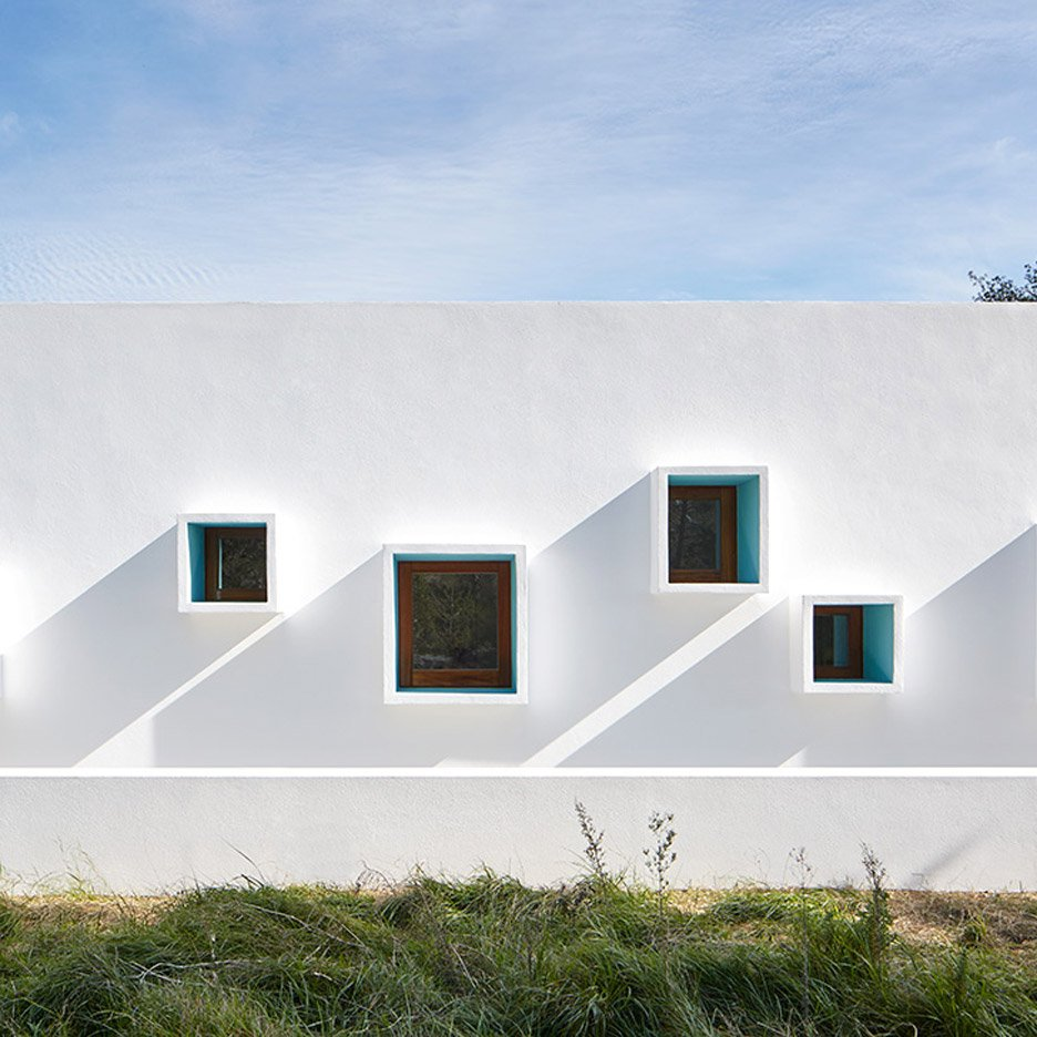 Ca na Maria is a bright white Ibiza home with an assortment of protruding windows