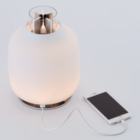 Candela light by Francisco Gomez Paz combines eco-friendly fuel with LEDs and a phone charger