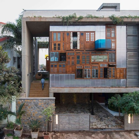 Reclaimed windows and doors form facades of Collage House by S+PS Architects